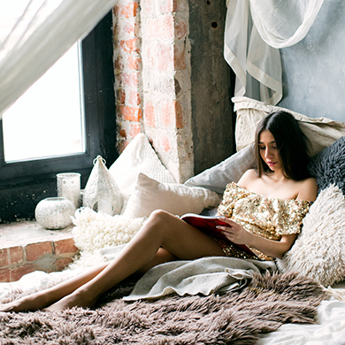 A woman relaxinig and reading her daily affirmations